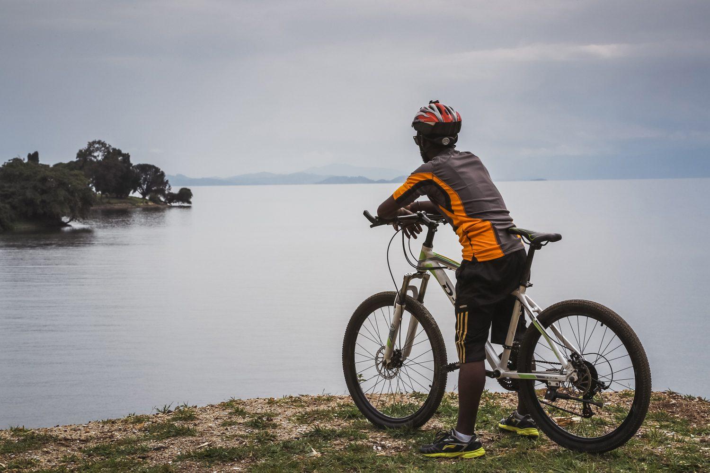 A cyclist near Kivu lake in Incredible Rwanda