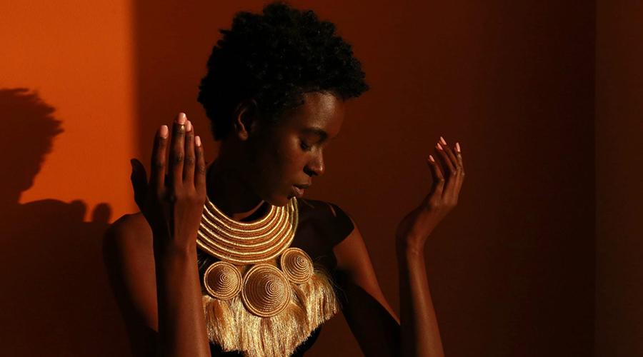 A rwandan fashion model wearing a made in Rwanda product